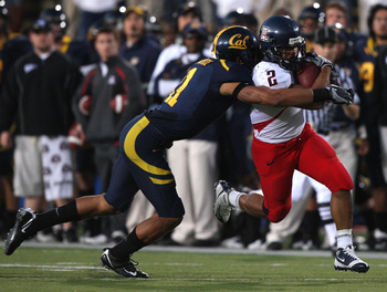 BERKELEY, CA - NOVEMBER 14:  Keola Antolin #2 of the Arizona Wildcats runs against Sean Cattouse #11 of the California Golden Bears at California Memorial Stadium on November 14, 2009 in Berkeley, California.  (Photo by Jed Jacobsohn/Getty Images)