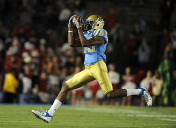 PASADENA, CA - SEPTEMBER 11:  Nelson Rosario #83 of UCLA makes a catch against Stanford at the Rose Bowl on September 11, 2010 in Pasadena, California.  (Photo by Harry How/Getty Images)