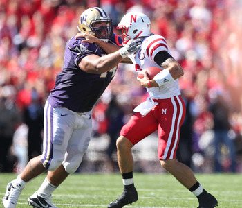 SEATTLE - SEPTEMBER 18: Quarterback Taylor Martinez #3 of the Nebraska Cornhuskers is tackled by Alameda Ta'amu #74 of the Washington Huskies on September 18, 2010 at Husky Stadium in Seattle, Washington. (Photo by Otto Greule Jr/Getty Images)