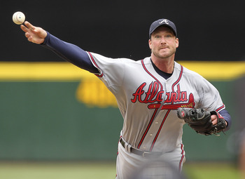 SEATTLE - JUNE 29:  Starting pitcher Derek Lowe #32 of the Atlanta Braves pitches against the Seattle Mariners at Safeco Field on June 29, 2011 in Seattle, Washington. (Photo by Otto Greule Jr/Getty Images)