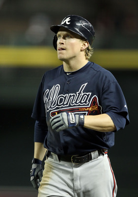 PHOENIX, AZ - MAY 18:  Nate McLouth #13 of the Atlanta Braves bats against the Arizona Diamondbacks during the Major League Baseball game at Chase Field on May 18, 2011 in Phoenix, Arizona.  The Diamondbacks defeated the Braves 5-4 in eleven innings.  (Ph