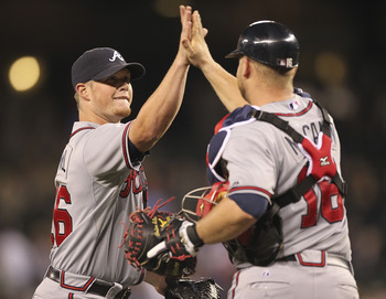 SEATTLE - JUNE 28:  Closing pitcher Craig Kimbrel #46 of the Atlanta Braves celebrates with catcher Brian McCann #16 after defeating the Seattle Mariners 5-4 at Safeco Field on June 28, 2011 in Seattle, Washington. (Photo by Otto Greule Jr/Getty Images)