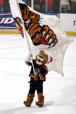 SUNRISE, FL - DECEMBER 15: T he Florida Panthers Mascot Stanley C. Panther waves the team flag after the Florida Panthers defeated the Detroit Redwings 3-2 in overtime at the Bank Atlantic Center on December 15, 2005 in Sunrise, Florida.  (Photo by Eliot