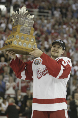 DETROIT, MI - JUNE 13:  Most valuable player Nicklas Lidstrom #5 of the Detroit Red Wings celebrates with Conn Smythe trophy the after defeating the Carolina Hurricanes in game 5 of the 2002 Stanley Cup Finals on June 13, 2002 at Joe Louis Arena in Detroi
