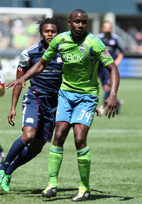 SEATTLE, WA - JUNE 26:  Jhon Kennedy Hurtado #34 of the Seattle Sounders FC battles Kenny Mansally #7 of the New England Revolution at CenturyLink Field on June 26, 2011 in Seattle, Washington. (Photo by Otto Greule Jr/Getty Images)