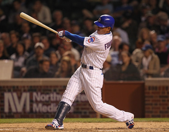 CHICAGO, IL - JUNE 14:  Kosuke Fukudome #1 of the Chicago Cubs hits a double in the 8th inning against the Milwaukee Brewers at Wrigley Field on June 14, 2011 in Chicago, Illinois. The Cubs defeated the Brewers 5-4 in 10 innings.  (Photo by Jonathan Danie