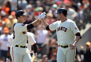 SAN FRANCISCO, CA - APRIL 24:  Aubrey Huff #17 congratulates Buster Posey #28 of the San Francisco Giants after Posey hits a two run home run against the Atlanta Braves at AT&T Park on April 24, 2011 in San Francisco, California.  (Photo by Ezra Shaw/Gett