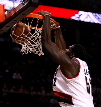 PORTLAND, OR - DECEMBER 09:  Greg Oden #52 of the Portland Trail Blazers dunks over Dwight Howard #12 of the Orlando Magic at the Rose Garden on December 9, 2008 in Portland, Oregon.  NOTE TO USER: User expressly acknowledges and agrees that, by downloadi