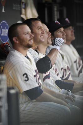 MINNEAPOLIS, MN - MAY 23: Jason Kubel #16, Jim Thome #25 and Justin Morneau #33 of the Minnesota Twins in the dugout following a Thome home run against the Seattle Mariners during their game on May 23, 2011 at Target Field in Minneapolis, Minnesota. The R