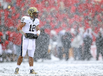 CINCINNATI, OH - DECEMBER 04:  Tino Sunseri #12 of the Pittsburgh Panthers looks to the sidelines during the Big East Conference game against the Cincinnati Bearcats at Nippert Stadium on December 4, 2010 in Cincinnati, Ohio.  Pittsburgh won 28-10.  (Phot