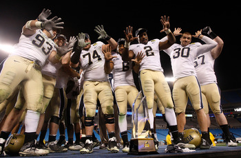 CHARLOTTE, NC - DECEMBER 26:  The Pittsburgh Panthers celebrate a 19-17 victory over the North Carolina Tar Heels after their game on December 26, 2009 in Charlotte, North Carolina.  (Photo by Streeter Lecka/Getty Images)