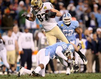 CHARLOTTE, NC - DECEMBER 26:  Mike Shanahan #87 of the Pittsburgh Panthers jumps over Melvin Williams #10 of the North Carolina Tar Heels during their game on December 26, 2009 in Charlotte, North Carolina.  (Photo by Streeter Lecka/Getty Images)