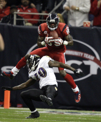 HOUSTON, TX - DECEMBER 13:  Wide receiver Andre Johnson #80 of the Houston Texans scores on a pass as he goes over safety Ed Reed #20 of the Baltimore Ravens in the second quarter at Reliant Stadium on December 13, 2010 in Houston, Texas.  (Photo by Bob L