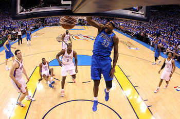 OKLAHOMA CITY, OK - MAY 21:  Brendan Haywood #33 of the Dallas Mavericks dunks the ball in the first half while taking on the Oklahoma City Thunder in Game Three of the Western Conference Finals during the 2011 NBA Playoffs at Oklahoma City Arena on May 2