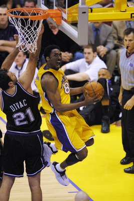 8 May 2001:  Kobe Bryant #8 of the Los Angeles Lakers puts a shot up against Vlade Divac #21 of the Sacramento Kings  in game one of the western conference semi-finals at Staples Center in Los Angeles, California.  The Lakers won 96-90.  DIGITAL IMAGE.  M