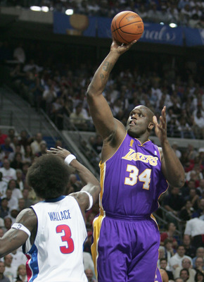 AUBURN HILLS, MI - JUNE 15:  Shaquille O'Neal #34 of the Los Angeles Lakers shoots over Ben Wallace #3 of the Detroit Pistons in the first quarter of game five of the 2004 NBA Finals on June 15, 2004 at The Palace of Auburn Hills in Auburn Hills, Michigan