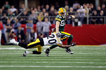 ARLINGTON, TX - FEBRUARY 06:  Jordy Nelson #87 of the Green Bay Packers runs for yards after the catch against Bryant McFadden #20 of the Pittsburgh Steelers during Super Bowl XLV at Cowboys Stadium on February 6, 2011 in Arlington, Texas.  (Photo by Kevi