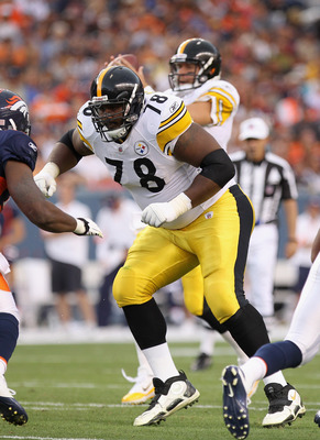 DENVER - AUGUST 29:  Offensive tackle Max Starks #78 of the Pittsburgh Steelers defends quarterback Ben Rothlisberger #7 against the Denver Broncos during preseason NFL action at INVESCO Field at Mile High on August 29, 2010 in Denver, Colorado. The Bronc