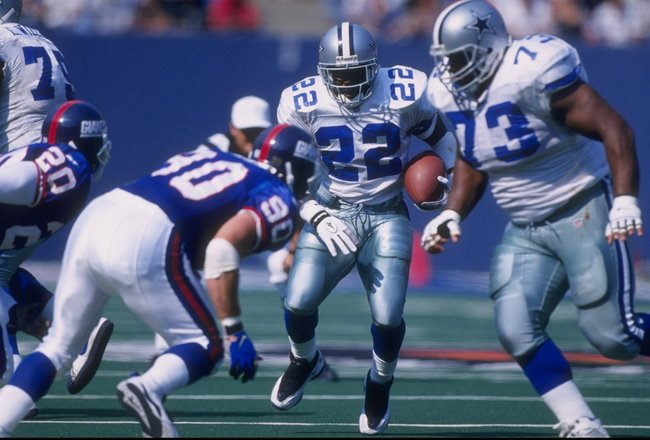 4 Oct 1997:  Emmitt Smith #22 of the Dallas Cowboys runs with the ball  as teammate Larry Allen #73 sets up to block Corey Widmer #90 of the New York Giants during a game at the Meadowlands in East Rutherford, New Jersey. The Giants defeated the Cowboys 2