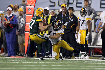 ARLINGTON, TX - FEBRUARY 06:  Jordy Nelson #87 of the Green Bay Packers makes a reception against Troy Polamalu #43 of the Pittsburgh Steelers during Super Bowl XLV at Cowboys Stadium on February 6, 2011 in Arlington, Texas. Packers won 31-25.  (Photo by