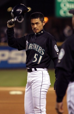 SEATTLE - OCTOBER 1:  Outfielder Ichiro Suzuki #51 of the Seattle Mariners celebrates after tying George Sisler's 84-year-old record for hits in a single season, during the game against the Texas Rangers on October 1, 2004 at Safeco Field in Seattle, Wash