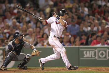 BOSTON, MA  - JUNE 21:  Josh Reddick #16 of the Boston Red Sox knocks in a run against the San Diego Padres at Fenway Park on June 21, 2011 in Boston, Massachusetts.  (Photo by Jim Rogash/Getty Images)