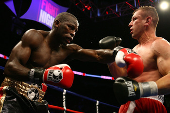 NEWARK, NJ - DECEMBER 11:  Steve Cunningham punches Tomasz Adamek during their IBF Cruiserweight Championship fight on December 11, 2008 at The Prudential Center in Newark, New Jersey.  Tomasz won a split decision.  (Photo by Al Bello/Getty Images)