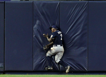 NEW YORK, NY - JUNE 29:  Nyjer Morgan #2 of the Milwaukee Brewers misses a ball hit by Robinson Cano #24 of the New York Yankees resulting in a triple during their game on June 29, 2011 at Yankee Stadium in the Bronx borough of New York City.  (Photo by A