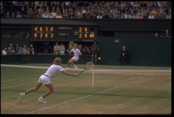 JUN 1977:  BJORN BORG OF SWEDEN LEAPS ACROSS TO REACH A HIGH BALL DURING A MATCH AT THE 1977 WIMBLEDON TENNIS CHAMPIONSHIPS.