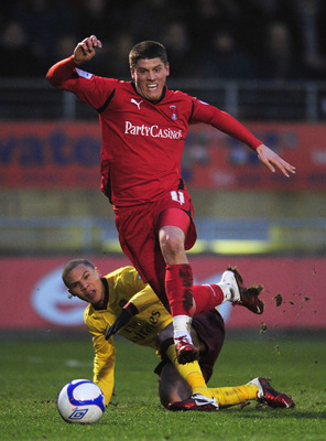 LONDON, ENGLAND - FEBRUARY 20: Alex Revell of Leyton Orient (front) evades a challenge by Kieran Gibbs of Arsenal during the FA Cup sponsored by E.ON 5th Round match between Leyton Orient and Arsenal at the Matchroom Stadium on February 20, 2011 in London