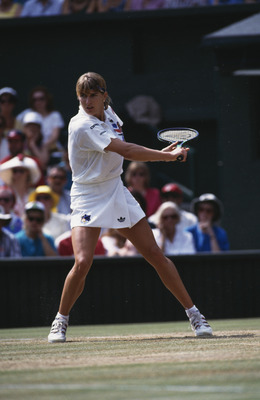 German tennis player Steffi Graf playing Jana Novotna of the Czech Republic in the Ladies' Singles final at Wimbledon, London, 4th July 1993. Graf won the match 7-6 (6), 1-6, 6-4. (Photo by Bob Martin/Getty Images)