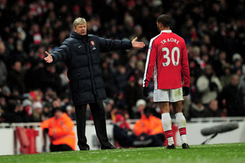 LONDON, ENGLAND - JANUARY 09:  Manager of Arsenal Arsene Wenger speaks to Armand Traore of Arsenal during the Barclays Premier League match between Arsenal and Everton at Emirates Stadium on January 9, 2010 in London, England.  (Photo by Shaun Botterill/G