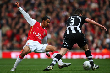LONDON - JANUARY 26:  Theo Walcott of Arsenal is beaten by Sanchez Jose Enrique of Newcastle United during the FA Cup Sponsored by e.on Fourth Round match between Arsenal and Newcastle United at the Emirates Stadium on January 26, 2008 in London, England.