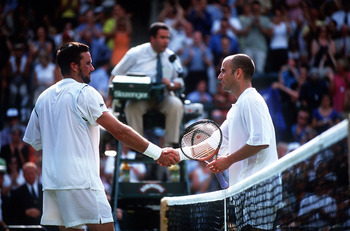 6 Jul 2001:  A victorious Patrick Rafter of Australia shakes hands with Andre Agassi of the USA after the men's semi finals of The All England Lawn Tennis Championship at Wimbledon, London. Mandatory Credit: Clive Brunskill/ALLSPORT