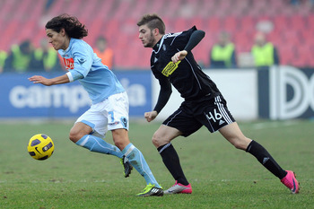 NAPLES, ITALY - FEBRUARY 06:  Edinson Cavani of Napoli (L) and Davide Santon of Cesena compete for the ball during the Serie A match between SSC Napoli and AC Cesena at Stadio San Paolo on February 6, 2011 in Naples, Italy.  (Photo by Giuseppe Bellini/Get
