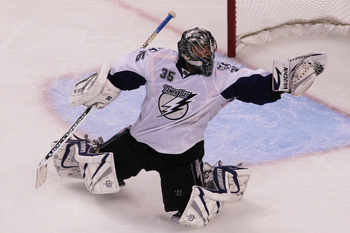 BOSTON, MA - MAY 27:  Dwayne Roloson #35 of the Tampa Bay Lightning reaches for a glove save in Game Seven of the Eastern Conference Finals during the 2011 NHL Stanley Cup Playoffs at TD Garden on May 27, 2011 in Boston, Massachusetts.  (Photo by Jim Roga