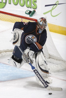 EDMONTON, CANADA - JANUARY 18: Nikolai Khabibulin #35 of the Edmonton Oilers defends the goal against the Minnesota Wild on January 18, 2011 at Rexall Place in Edmonton, Alberta, Canada. (Photo by Dale MacMillan/Getty Images)