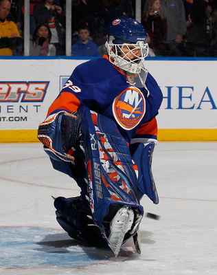 UNIONDALE, NY - MARCH 24:  Goalie Rick DiPietro #39 of the New York Islanders makes a save during warmups before an NHL hockey game against the Atlanta Thrashers at the Nassau Coliseum on March 24, 2011 in Uniondale, New York.  (Photo by Paul Bereswill/Ge