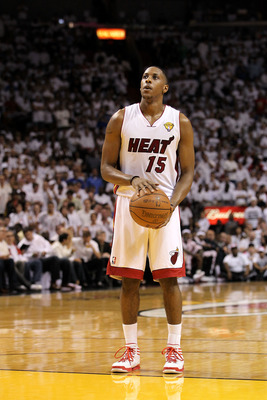 MIAMI, FL - JUNE 12:  Mario Chalmers #15 of the Miami Heat gets set to shoot a free throw attempt against the Dallas Mavericks in Game Six of the 2011 NBA Finals at American Airlines Arena on June 12, 2011 in Miami, Florida. NOTE TO USER: User expressly a