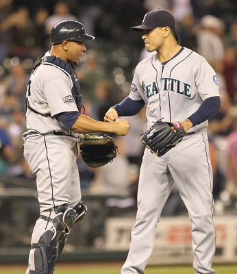 SEATTLE - JUNE 26:  Closing pitcher Brandon League #43 (R) of the Seattle Mariners celebrates with catcher Miguel Olivo #30 after defeating the Florida Marlins 2-1 in ten innings at Safeco Field on June 26, 2011 in Seattle, Washington. (Photo by Otto Greu