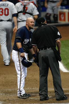 MILWAUKEE, WI - JUNE 24: Casey McGehee #14 of the Milwaukee Brewers argues with umpire Ron Kulpa after being tagged out at home plate against the Minnesota Twins at Miller Park on June 24, 2011 in Milwaukee, Wisconsin. (Photo by Scott Boehm/Getty Images)