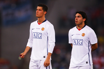 ROME - MAY 27:  Carlos Tevez of Manchester United and Cristiano Ronaldo of Manchester United look dejected after Barcelona won the UEFA Champions League Final match between Barcelona and Manchester United at the Stadio Olimpico on May 27, 2009 in Rome, It