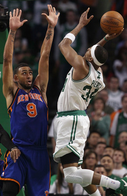 BOSTON, MA - APRIL 19:  Paul Pierce #34 of the Boston Celtics takes a shot as Jared Jeffries #9 of the New York Knicks in Game Two of the Eastern Conference Quarterfinals in the 2011 NBA Playoffs on April 19, 2011 at the TD Garden in Boston, Massachusetts