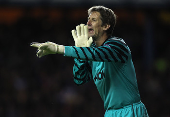 GLASGOW, SCOTLAND - NOVEMBER 24:  Edwin van der Sar of Manchester United during the UEFA Champions League Group C match between Glasgow Rangers and Manchester United at Ibrox on November 24, 2010 in Glasgow, Scotland.  (Photo by Alex Livesey/Getty Images)