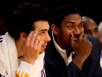 LOS ANGELES - JANUARY 3: Ron Artest ##37 (R) of the Los Angeles Lakerssits in street clothes on the banch with Sasha Vujacic #18 in the game against the Dallas Mavericks on January 3, 2010 at Staples Center in Los Angeles, California. NOTE TO USER: User e