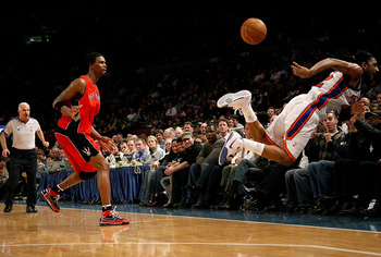 NEW YORK - JANUARY 11:  Chris Bosh #4 of the Toronto Raptors watches Renaldo Balkman #32 of the New York Knicks dive for the ball on January 11, 2008 at Madison Square Garden in New York City. NOTE TO USER: User expressly acknowledges and agrees that, by