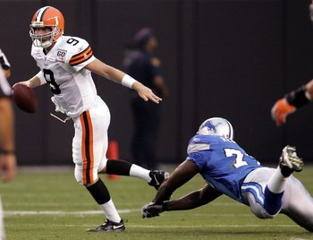 CLEVELAND - AUGUST 18:  Charlie Frye #9 of the Cleveland Browns escapes the tackle of Cory Redding #78 of the Detroit Lions during a pre season game at Cleveland Browns Stadium on August 18, 2006 in Cleveland, Ohio. (Photo By Gregory Shamus/Getty Images)
