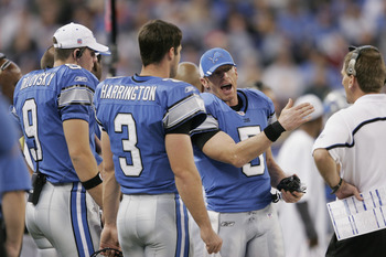 DETROIT - NOVEMBER 13:  Quarterback Jeff Garcia #5 of the Detroit Lions talks to quarterback Dan Orlovsky #9 and Joey Harrington #3 and quarterbacks coach Greg Olson against the Arizona Cardinals at Ford Field on November 13, 2005 in Detroit, Michigan. Th
