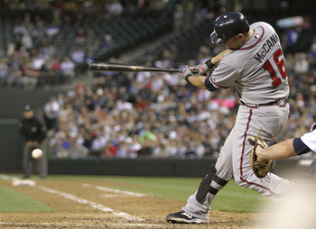 SEATTLE - JUNE 28:  Brian McCann #16 of the Atlanta Braves hits a two RBI single in the seventh inning against the Seattle Mariners at Safeco Field on June 28, 2011 in Seattle, Washington. (Photo by Otto Greule Jr/Getty Images)