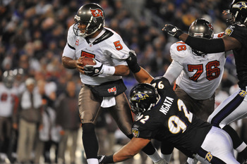 BALTIMORE, MD - NOVEMBER 28:  Josh Freeman #5 of the Tampa Bay Buccaneers is almost sacked by Haloti Ngata #92 of the Baltimore Ravens at M&T Bank Stadium on November 28, 2010 in Baltimore, Maryland. The Ravens defeated the Buccaneers 17-10. (Photo by Lar